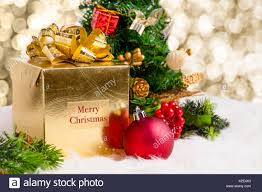shiny gold gift box with merry christmas word with red decoration