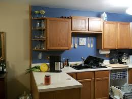 blue kitchen walls with brown cabinets light blue kitchen walls ideas 5908 baytownkitchen blue