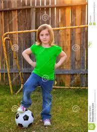 blond little soccer player happy in backyard stock