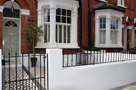 front garden wall painted white metal wrought iron rail and gate