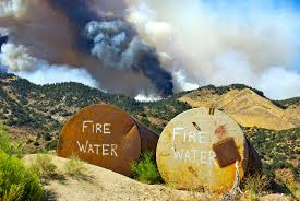 Wildfire History by File Two Tanks Marked Fire Water Sit In Readiness To Be Used As A