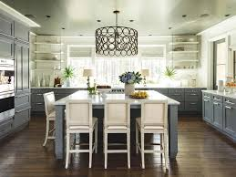 glass front cabinets gray countertop pendant lights glossy subway