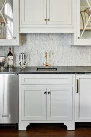 black kitchen cabinets with marble countertops black marble countertops with white cabinets transitional