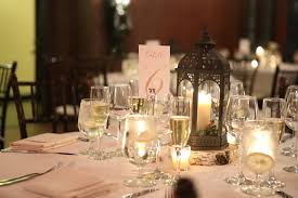 willowdale estate wedding cost winter wedding centerpiece with lanterns and candles at willowdale