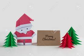 origami santa claus paper craft with christmas trees and a merry