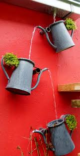 decorative watering cans cascading watering can feature create a decorative drainage