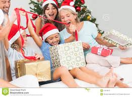 happy family at opening gifts together stock photo