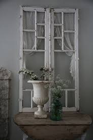 an old window can be a cool decoration for a shabby chic entryway