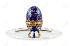 easter egg stands the casket for jewelry as easter egg stands on a silver plate