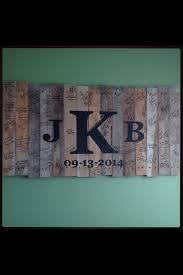 wedding registry books my husband made a sign out of pallet wood and painted our monogram