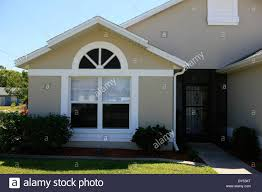 suburban florida house with a two car garage stock photo royalty stock photo suburban florida house with a two car garage