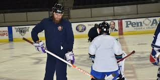 bentley college hockey former rival goalie helps pensacola youth hockey group