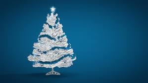 silver artificial tree made of tinsel grows from gift