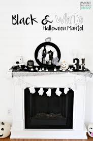 darling black and white halloween decor for the mantel and piano