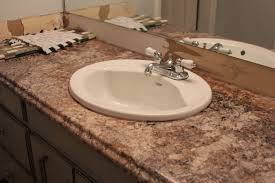 bathroom brown lowes counter tops with white cabinets and tile