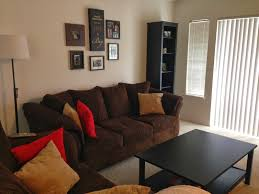 living room beautiful with brown fabric couches grey painting