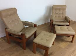 pair of vintage reclining chairs with footstools by svend dyrlund
