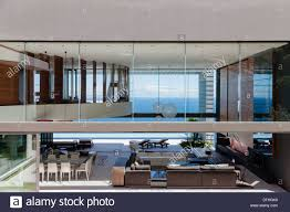 glass walls of modern house overlooking ocean stock photo royalty