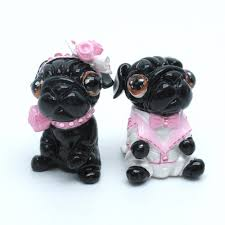 black pug wedding cake topper pink wedding color scheme figurine