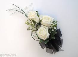 and black corsage flowers corsage in ivory and black