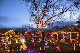 christmas hers lights up neighborhood for christmas