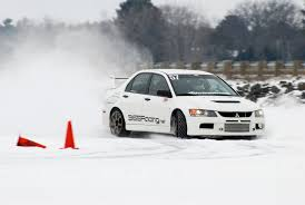 bbc autos with a 500hp evo 9 racing on ice with studded tires 500hp boosted films youtube