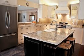 white kitchen with black island galaxy white granite kitchen traditional with black island farm