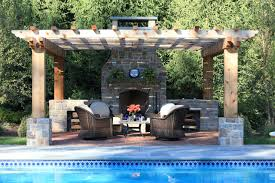 pool pergola patio and a fireplace