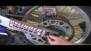 solved how to tighten the chain adjustment on a 2004 fixya