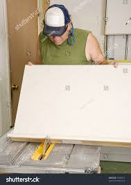 Saw For Cutting Laminate Flooring Carpenter Using Table Saw Cut Laminate Stock Photo 21938311
