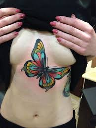 with colored butterfly on chest tattooshunt com
