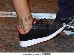 rihanna rihanna running from the gym showing off her new tattoo