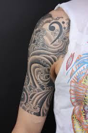water tattoo wave tattoo sleeve and tatting