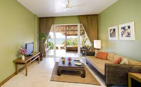 homely furniture with large glass door and big chocolate drapes on