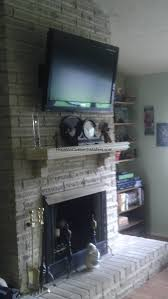tv on brick fireplace installation houston custom installers