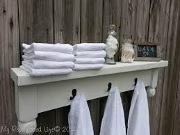 White Bathroom Shelf With Hooks by White Bathroom Shelf With Towel Hooks Perplexcitysentinel Com