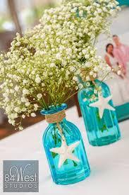 Wedding Centerpieces Using Mason Jars by Beautiful Beach Themed Centerpiece Using Blue Mason Jars Starfish