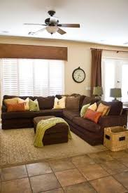 brown livingroom five ways to decorate with a brown sofa yellow pillows wall
