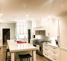 white kitchen cabinets with marble counters modern white kitchen cabinets with a stainless steel appliances