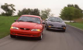 camaro vs mustang the rivalry of the century mustang vs camaro ford addict