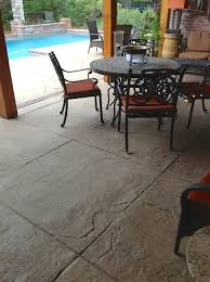 stamped textured concrete patio area with diamond scoring pattern