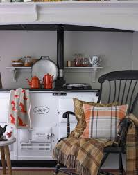 love the foxes in this cosy country kitchen with white aga and