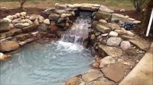 natural stone pond w waterfall envisions landscape construction