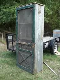 how to build a wood cabinet with doors old screen door cabinet i d like to use this for extra storage