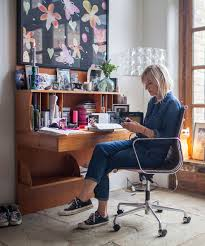 jo whiley sits at her wooden desk on a leather and stainless steel