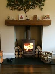 charnwood c four in bronze honed granite hearth um character um colour oak fireplace beam