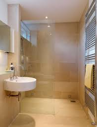 bathroom frameless glass shower door and white wall mounted sink