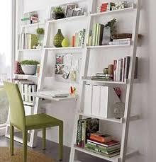 White Leaning Bookshelves by Decorating With Leaning Ladder Shelves Leaning Shelves Are