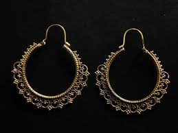 a pair of indian hoop earrings designed to perfection the