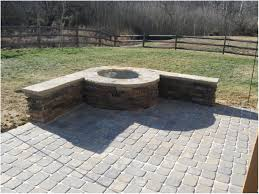 a circular paver patio and seating wall create a destination pics